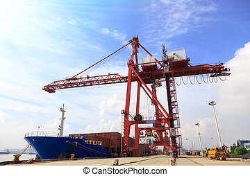 Moored container ship and cranes in a harbor