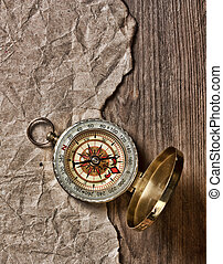 compass, old paper and rope