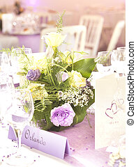 Wedding decoration with flowers and place card in yellow and...