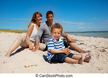 Mixed Race Family Looking Happy on the Beach
