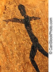 woman shadow on rock