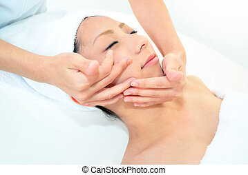 Woman receiving facial massage - Pretty woman receiving...