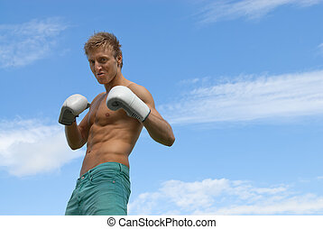 Tough guy in boxing gloves - Tough angry guy in boxing...
