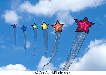 colorful kites - string of colorful star kites during the...