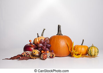 Fall Arrangement - A group of fall decorations all sit...
