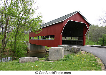 Covered Bridge - this brightly coloured red bridge spans a...