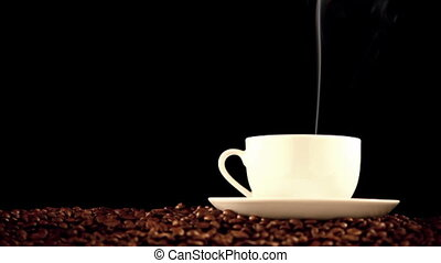 Coffe cup - warm cup of coffee on black background