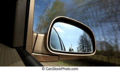 Fast drive - Landscape in the sideview mirror of a speeding...