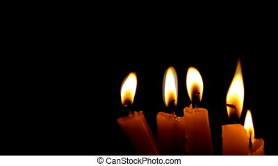 Burning candles - Closeup of burning candle isolated on...