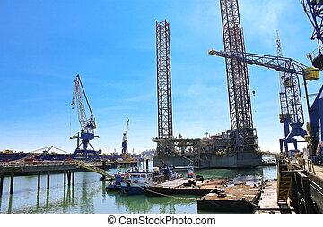 Offshore drilling platform in repair in shipyard