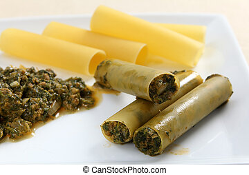 Stuffing cannelloni - Cannelloni tubes being stuffed with a...