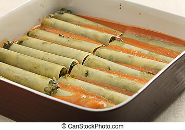 Cannelloni in baking dish - Stuffed cannelloni in a baking...