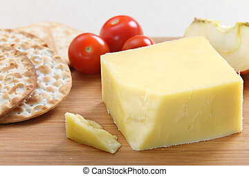 English Cheddar cheese - A wedge of English Cheddar cheese...
