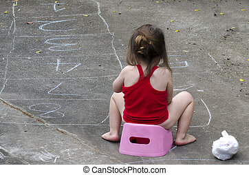 Potty training - Little baby site on a pink potty outdoor