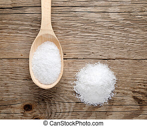 Pile of salt on wood background