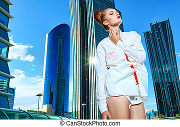 big city - Fashion model posing over big city background