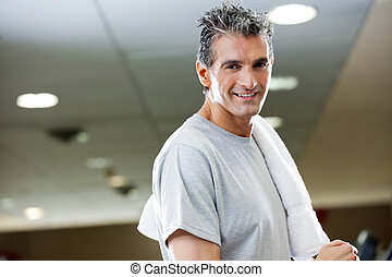 Man With Towel In Health Club - Portrait of mature man with...