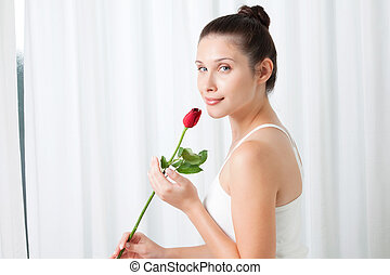 Young Woman with a Rose