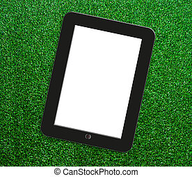 Tablet on the grass.