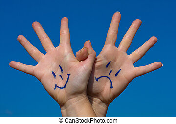 Linked hands with smiles and sadness pattern against the...