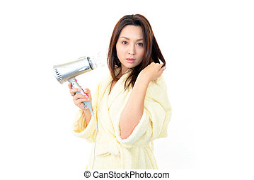 Beautiful woman holding hair dryer