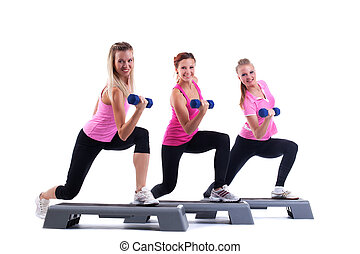 group training instructors with dumbbells - young group...