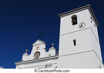 Church bell tower, Monda, Spain. - Top section of the...