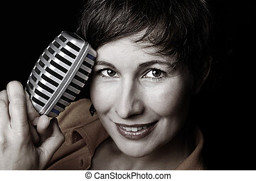 Portrait of female singer with microphone - A portrait of a...