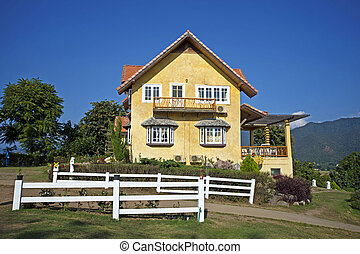 Landscape of yellow house