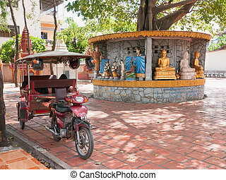 Tuk-tuk taxi at temple in Phnom Penh - Cambodian style...