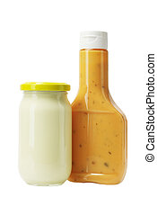Mayonnaise and Thousand Island Dressing in Glass Bottles on...