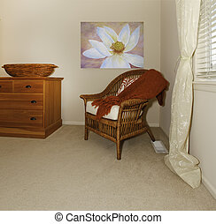 Corner with wood chair and dresser with painting.