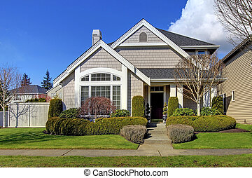 Classic new American house exterior in the spring. - Classic...
