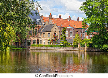 old brick house on the channel in Bruges in a sunny day....