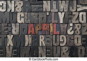 April - The word April written in antique letterpress...