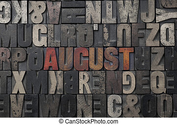 August - The word August written in antique letterpress...