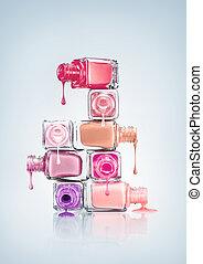 Nail Polish. - Nail polish dripping from stacked bottles.