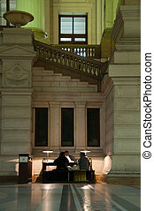 Desk in lobby courthouse - Lawyer sitting at desk with...