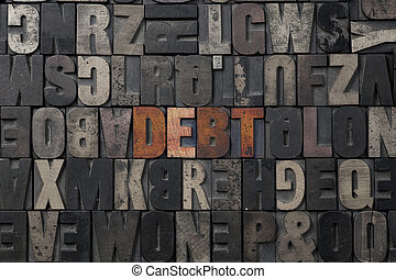 Debt - The word Debt written in antique letterpress printing...