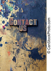 Contact Us - The words Contact Us written in antique...