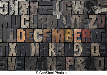 December - The word December written in antique letterpress...