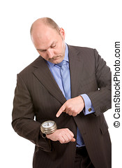 Keeping track of time - adult man pointing at the huge watch...