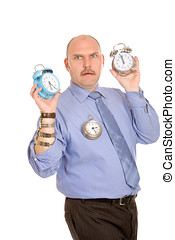 Time management - Businessman looking stressed with watches...