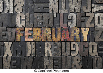 February - The word February written in antique letterpress...