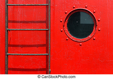 porthole and ladder on a red ship