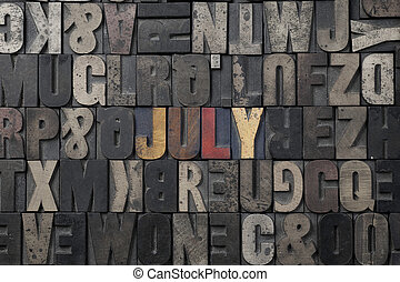 July - The word July written in antique letterpress printing...