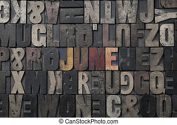June - The word June written in antique letterpress printing...