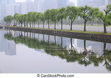 Tokyo smog - Tokyo, Japan - Imperial Palace gardens and the...