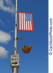 One Way - American flag, flowers and one way sign with arrow...