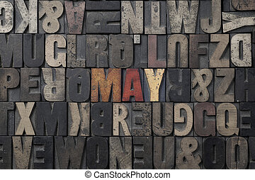 May - The word May written in antique letterpress printing...